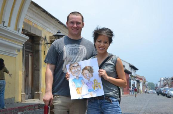 My brother and his girlfriend's pose with their caricature done by friend, Joel.